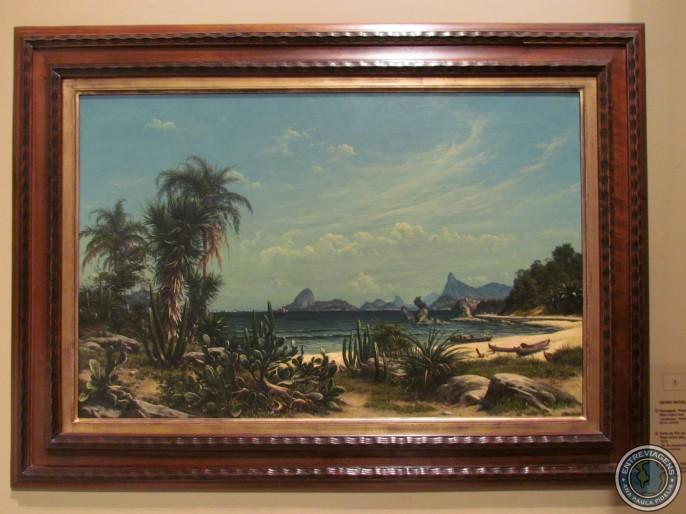 Olha só a praia de Icaraí com a Pedra do Índio e a Pedra do Itapuca, com o Pão de Açúcar e o Corcovado ao fundo. Pintura de Henri Nicolas Vinet, 1874.